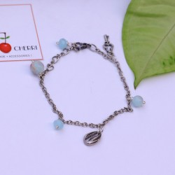 Silver Bracelet with Blue Beads & Charms